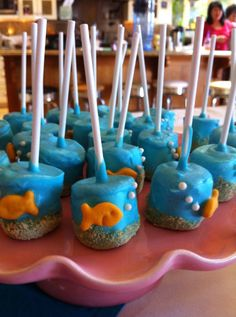 Cute idea for your under the sea baby shower theme.  These are some adorable cake pops that would go great with your under the sea baby shower theme.