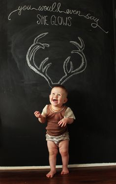 Draw antlers on a chalkboard and place toddler in front - tada!