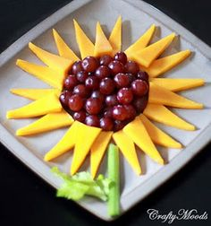 Sunflower made with cheese slices and grapes...for the kids