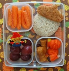 Fall themed Lunch, Acorn shaped sandwich, grapes, carrots and candy corn fall mix for a treat.