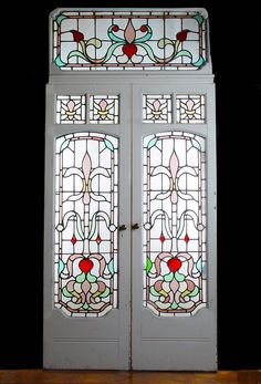 Entry from Light room to Glass room... A PAIR OF ART DECO PAINTED PINE STAINED GLASS CONSERVATORY DOORS WITH OVERDOOR. Circa 1930.