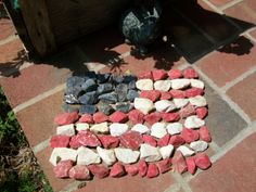 Paint rocks(I bought a bag of decorative white rocks at Lowes) red, white, and blue and form into our American Flag. I have a couple in my flower garden as well as this one on my porch.  Only problem, my cats love to bat them around and play with them!