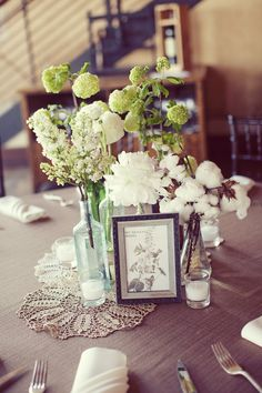 centerpiece -- use of votives, clear glass (milk glass too) and doilies with a framed element