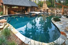 This home resort truly has it all, from the pool's swim-up bar by the full outdoor kitchen to the jumping rocks and waterfalls. Photo courtesy of Master Pools Builder: Medallion Pools http://www.luxurypools.com/builders-designers/master-pools-guild-inc.aspx