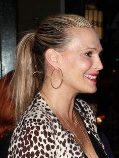 Molly Sims slicked back ponytail