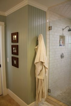 painted bead board walls and crown molding. Ceiling tile in shower is a nice detail also
