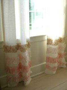 DIY:  curtains with strips of fabric ruffled near the bottom!