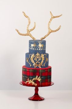 Tartan and reindeer antler red and gold Christmas cake -- I would lose the antlers.