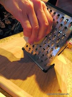 """Kitchen Tip: Simply spray the cheese grater with cooking spray before grating!  The """"grease"""" makes the cheese glide easily across the grates with less effort."""