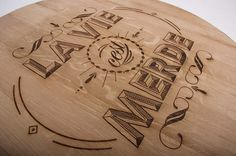 Laser Engraved Typography on repurposed wine barrel lids.