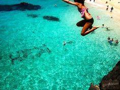 Cliff Jumping at Waimea Bay on the Island of Oahu, Hawaii