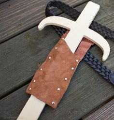 scrap leather and metal rivets to make play sword sheath - mother/son crafting time - sewfearless.com