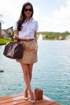 White short sleeve button down, animal print skirt and statement necklace; 32 Summer Work Outfits
