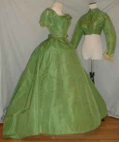 "Majestic-1860s-Green-Silk-Dress-w-Two-Bodices-Museum-De-accessioned, ebay seller: fiddybee, day bodice decorated w/ green satin pleated ruffles & rosettes, lined in cotton, front hook & eye closure; evening bodice - original lacings trimmed with silk tassels; peplum belt; bust: 34""; waist: 22""; skirt length: 41-58"""