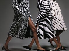 GRAPHIC FUR COATS From left: Michael Kors coat,  Versace coat, Altuzarra gloves (worn as scarf), Fendi coat, Roger Vivier shoes (on all),
