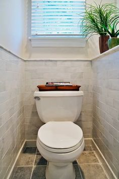 Tiny Half Bath Design, Pictures, Remodel, Decor and Ideas - page 6 half walled toilet area, tiled up the wall
