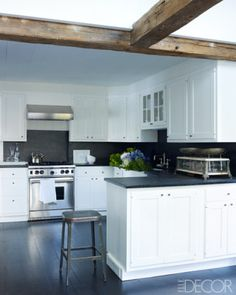 Wood beams keep a graphic kitchen from looking too stark.