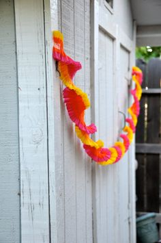 Crepe garland / streamer for party or birthday - pink, orange, yellow
