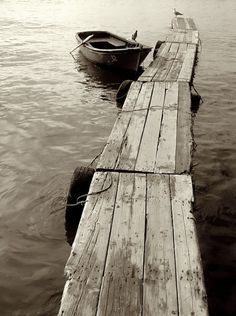 Reminders of my childhood: Old wooden docks and rowboats bobbing in the water.