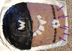 """Super easy Despicable Me evil purple minion birthday cake. Purple candles are great for hair and the flat """"stackers"""" marshmallows made for smores are easy to cut for teeth and the M."""