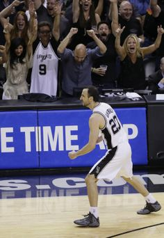 San Antonio Spurs win NBA title in five games over Miami Heat - San Antonio Spurs guard Manu Ginobili (20) celebrates against the Miami Heat during the second half in Game 5 of the NBA basketball finals on Sunday, June 15, 2014, in San Antonio. (AP Photo/Tony Gutierrez)