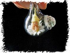 Micro Mini Baby Fairy in Blown Glass Droplet Pendant...I may just need this!