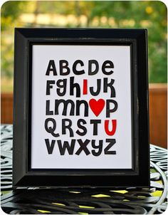 Easy and simple..Scrapbook stickers in black frame.   Super cute for kids rooms - use any color, but keep the red I heart u.