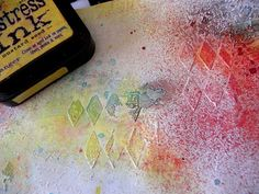 Spread some Claudine hellmuth gesso on the page with an old credit card. Stamp the wet gesso with a text stamp. When the gesso is dry, add texture with a stencil, mine is Harlequin from Crafter Workshop, you can use gesso, or Viva Croco Paint: transparent or DreamWeaver Crackle' paste. When the page is dry spritz it with your favourite mists.To highlight the texture I use several TH Distress Inks