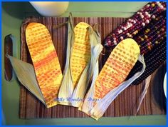 Indian corn decor made by rubbing crayon on a Lego board and gluing dried corn husks on the outside.