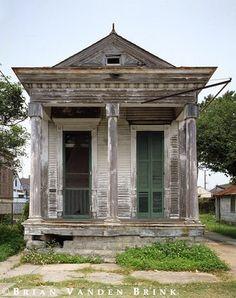abandoned tiny shotgun house