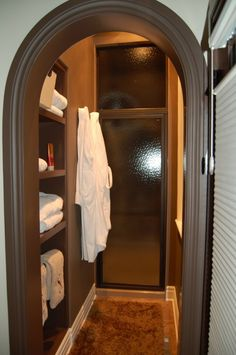 Warming room as you exit the shower. Heated lights allow the room to warm up before you have to get out of the shower. This area has storage for towels, robes, and lotions as you exit the shower. I need this.
