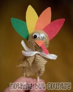 Pilgrim Crafts Ideas sucker wrapped in burlap with googly eyes and some feathers
