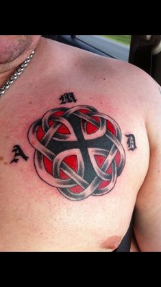 My Celtic Knot tattoo that is the symbol for Father & Daughter with my daughters initials around it.