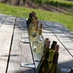 replace a board of the picnic table with a gutter to hold ice & drinks