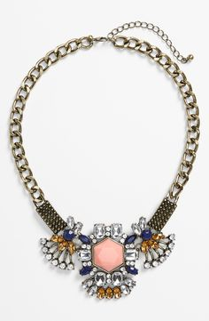 Dressing up a tee and jeans combo with this sparkly oversized crystal statement necklace.