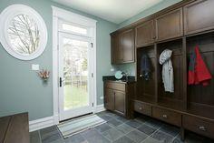 door with windows, sink in mudroom, floors
