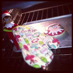 300+ Elf on the Shelf Photos -Cooking up some love in the oven.