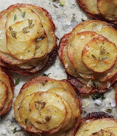 Mini Herbed Pommes Anna: Thinly sliced potatoes with butter, garlic & thyme prepared in muffin tins.