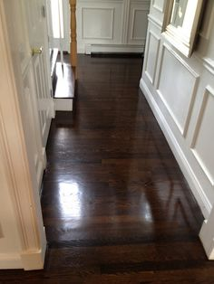 Rich dark brown solid wood flooring with light colored walls
