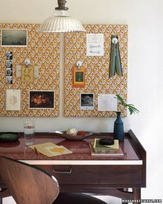 fabric-covered cork or magnet board. kitchen?