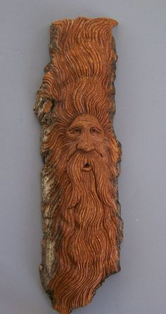 """Here is """"Eliyon"""" a woodspirit carved in cottonwood bark."""