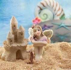 Fairies love sand castles in the fairy garden beach.