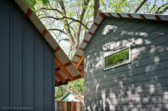 Fiber cement siding; board & batten on left, horizontal on left. Same material, both capped with corrugated metal roofing. (Moontower Residence in Austin, designed by Stuart Sampley Architect)