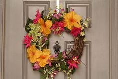 yellow amaryllis with pink dahlias, green berries, and small delicate flowers! I