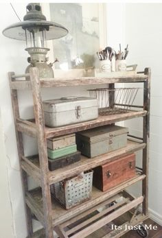 Antique shoe rack filled with vintage toolboxes and baskets holds bathroom supplies - via It's Just Me
