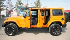 2012 Tricked out Jeep Wrangler Unlimited - Features: Lift Kit, Colour Accented Rims and Off Road Tires 780-435-3618 for info