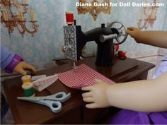 A closer look at a doll size vintage sewing machine from The Queen's Treasures.  It is so well done!