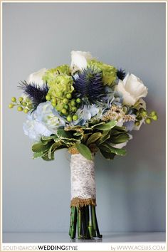 Wedding Bouquet Handle Idea  | Lace, Blue Thistle, Rose. When I get married I want a bouquet like this. I may not be engaged, but yes I look up wedding ideas