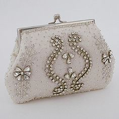View our collection of elegant designer beaded bridal purses & wedding handbags.  Exquisite beaded pearl & rhinestones handbags  designed by Moyna.  Find your style at Perfect Details.