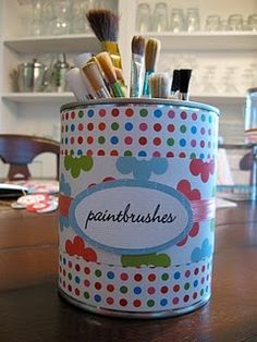 """""""Empty paint cans...."""" * I used ordinary  cans that had held baked beans or peaches. I covered mine with a simple remnant of a silver and cream textured wallpaper that I found in a bargain bin. I used a general purpose glue.  Cheap and easy craft - useful and eco-friendly too!"""